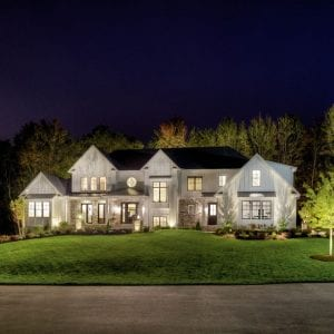 Stunning home featuring Kitcler landscape lighting